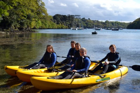 Students celebrate finishing their degree with a kayak adventure on Frenchman's Creek