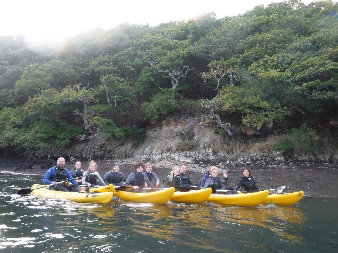 Students enjoy a lecture on a Koru Kayak Adventure!